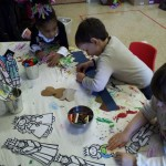 Shorashim students busily work on their Purim stick puppets