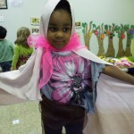 A Shorashim learner uses our classroom dress-up materials to transform herself into Queen Esther