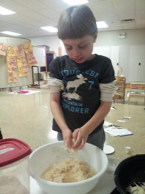 Squeezing the liquid out so that we have crispy לביבות (levivot--latkes).