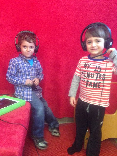 Two three year olds listen to and try and learn the מה נשתנה (Ma Nishtana-four questions).