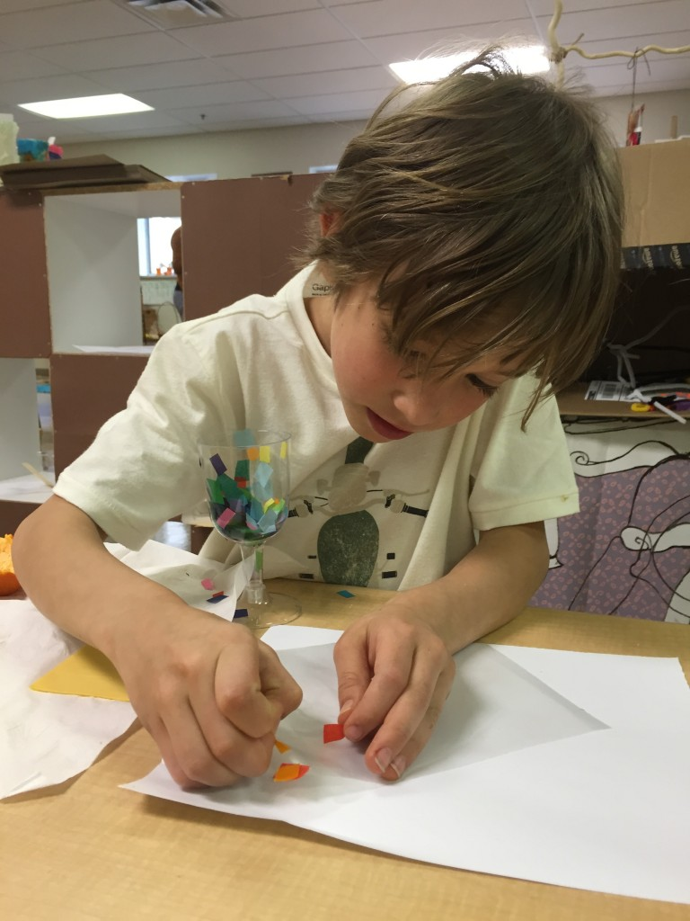A first grader works on his restful scene.