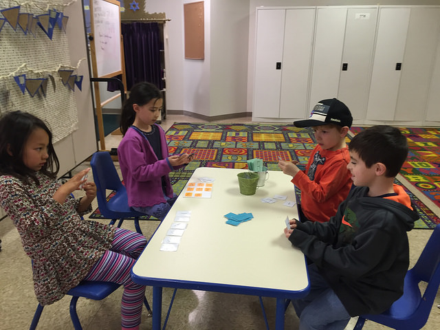 A group of four plays Go Fish.