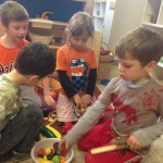 Four and five year olds work together to make food to share with poor people during the  שמיטה (Shmitah-release) year.