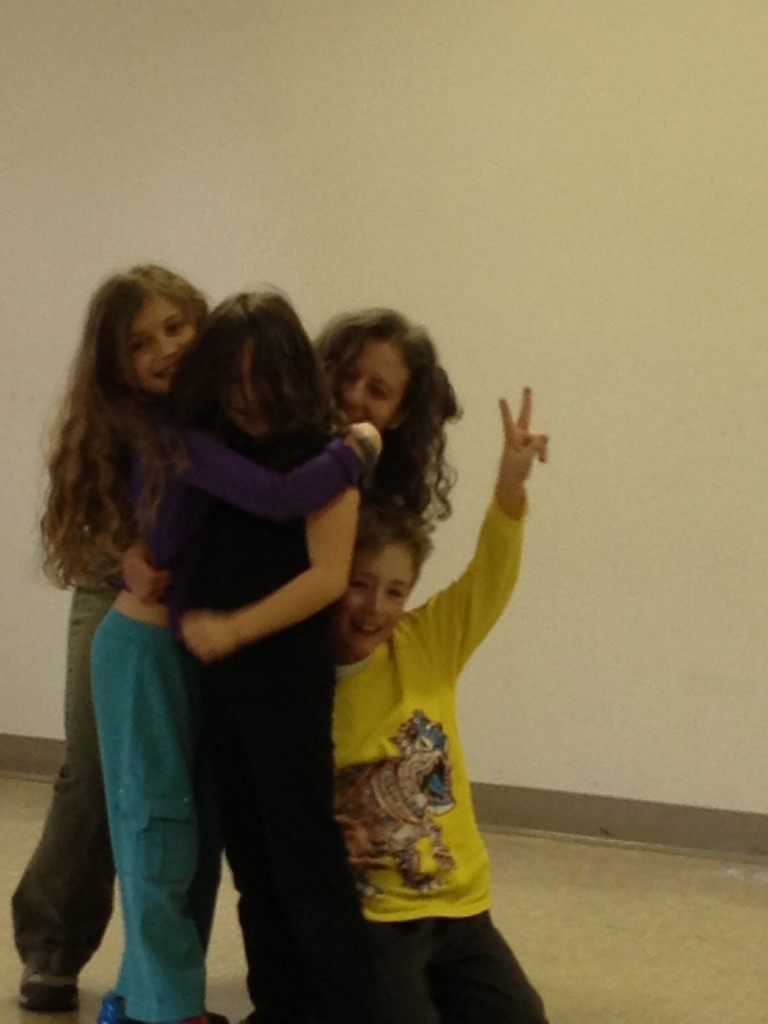 Spontaneous hug after a VERY exciting Hebrew tag game.