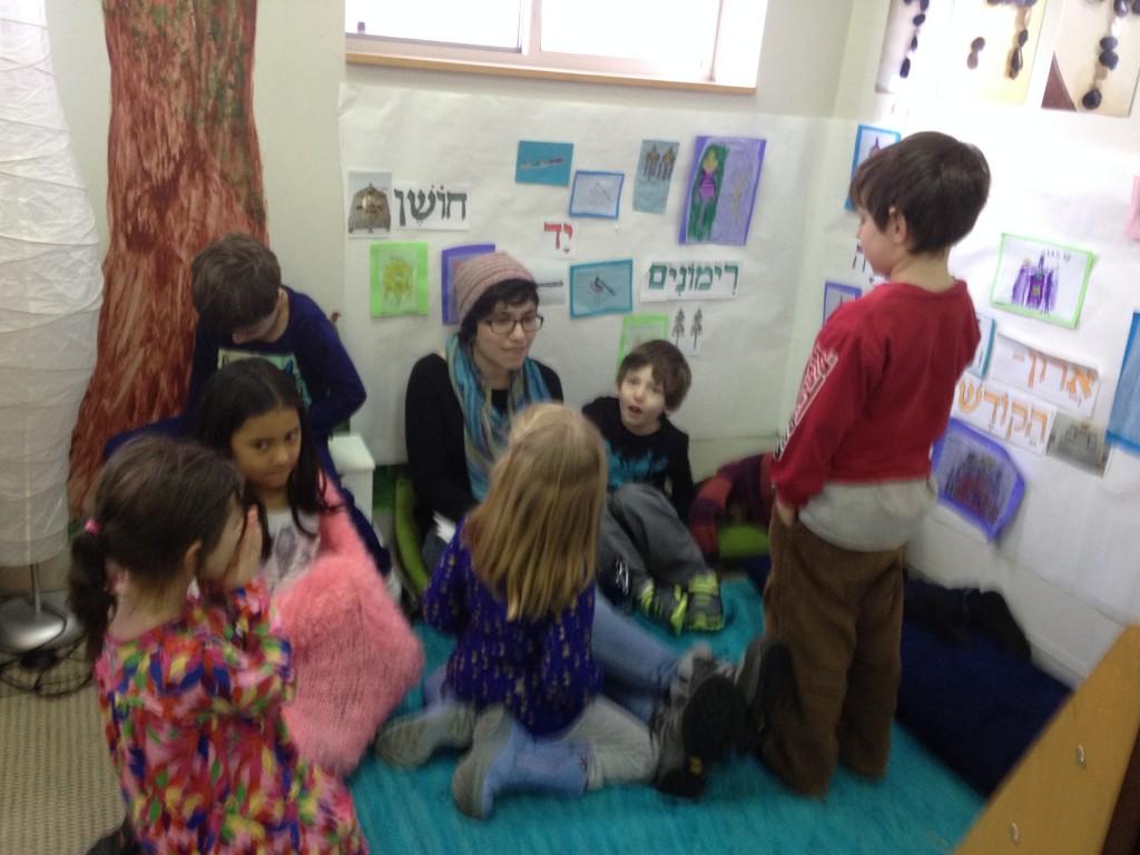 Nitzanim gathers to write a letter back to their pen pal.