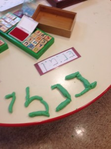 One of our Nitzanimers writes his Shem out of playdough!