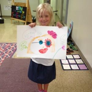 A Nitzanimer shows her self-portrait masterpiece.