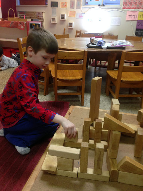 A five year old creates a base for the fighting scene between Judah Macabee and his army against the Syrian Greeks.