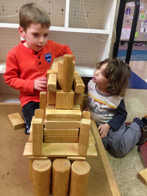 "A three and four year old work together to build a temple with ""a mess inside because the Jews still have to come fix it."""