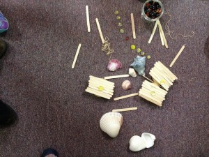 "This kindergartener built ""three rooms for praying,"" and a menorah (the yellow stones are candles, and the red stone is the shammash)."