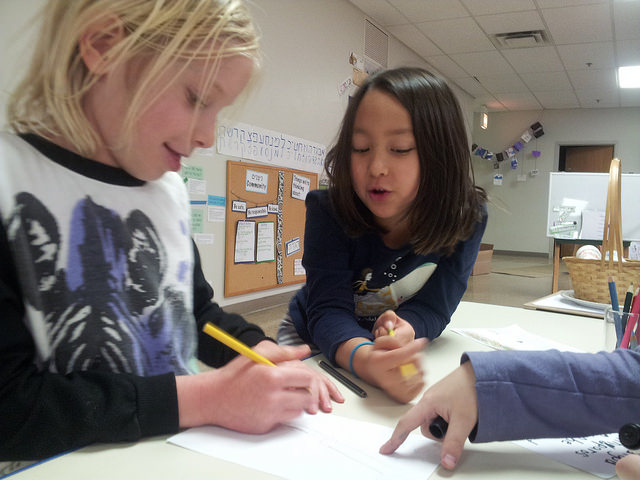 Two first graders discuss their drawings.