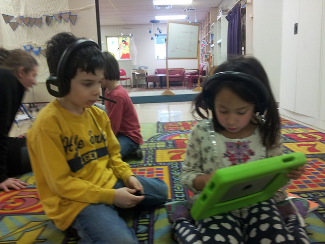 Two first graders practice digital flashcards on the iPad.