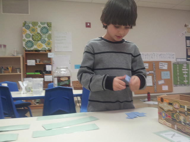 A first grader sorts and matches sight words.
