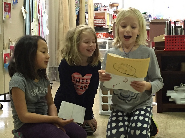 Three first graders share their work during מַעֲגָל סִיוּם (ma'agal siyyum--closing circle).