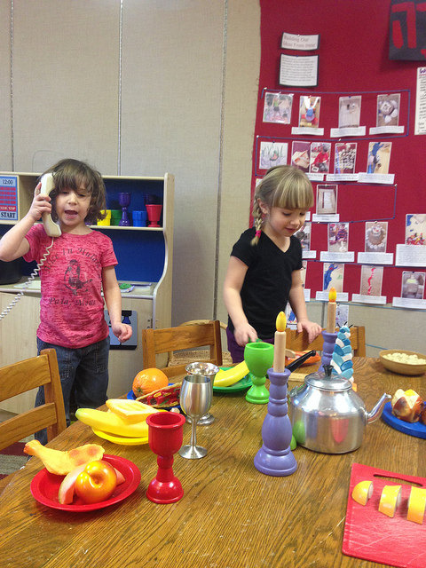"""Two four year olds make a Purim meal and then """"call"""" all of us to come join the party."""