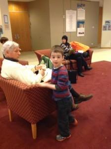 A Shteelimer gives his hamantaschen to his grandfather.