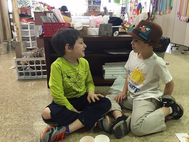 Two first graders ask questions and share ideas about שמיטה (sh'mitah—release).