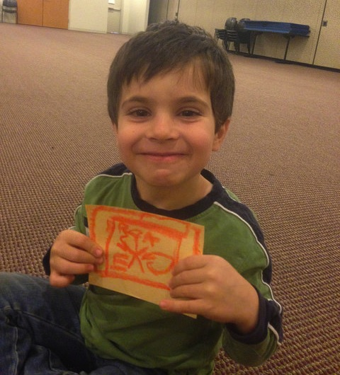 A four year old shares his drawing about how his body after running around then resting.