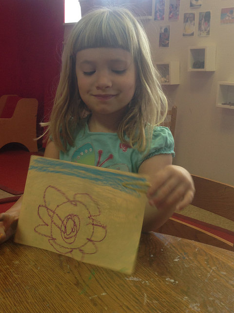 A four year old shares her drawing with us after our guided meditation.