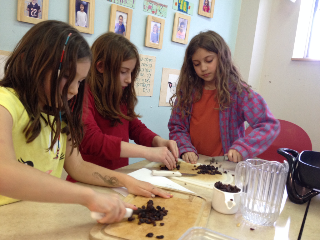 Chopping raisins and dates for Charosset.