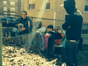 Shorashim and Shteelim children learn how to rip up newspaper to add to the compost