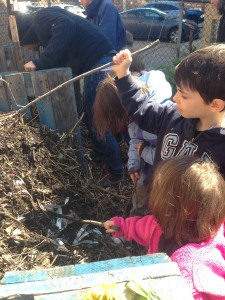 Children help mix up the compost