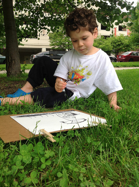 Drawing outside in nature.
