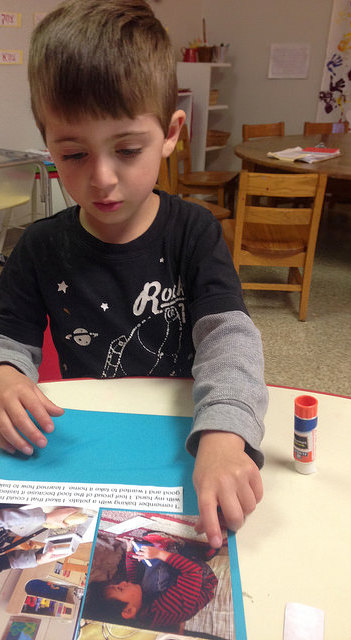 A four-year-old works on his individual page to share back with his friends.